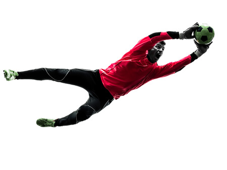 one  soccer player goalkeeper man catching ball in silhouette isolated white background Banco de Imagens - 38189872