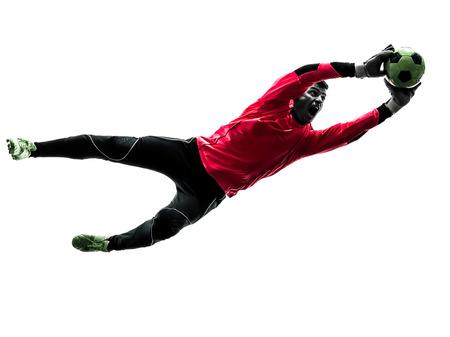 backlit: un jugador de f�tbol portero hombre atrapar la pelota en silueta aislado fondo blanco