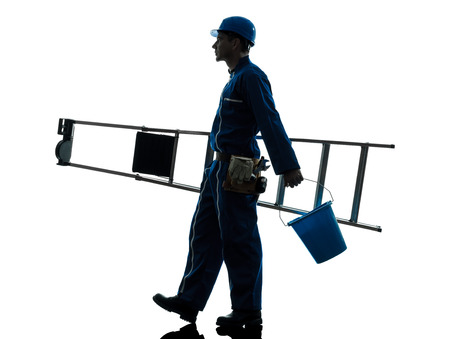 one  repairman worker ladder walking silhouette in studio on white background photo