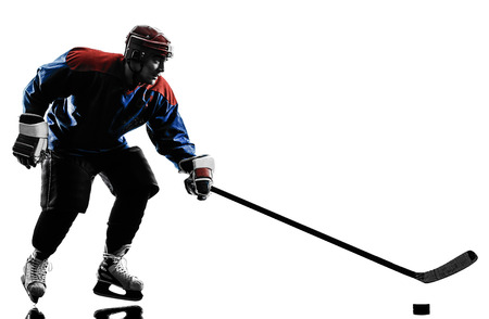 one caucasian man ice hockey player  in studio  silhouette isolated on white background Stock Photo