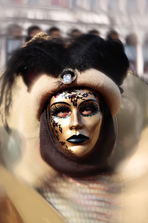 photoshop: wonderful fashion show of disguised people during the venice carnival in italyrthe effect is not a photoshop trick