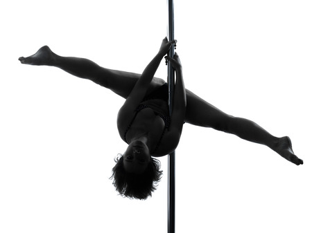 pole dancer: one  woman pole dancer dancing in silhouette studio isolated on white background