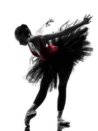 classical dance: one  young woman ballerina ballet dancer dancing with tutu in silhouette studio on white background Stock Photo