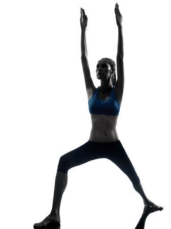 asanas: one  woman exercising yoga in silhouette studio isolated on white background Stock Photo
