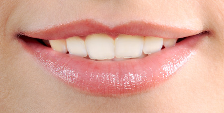 close up of beautiful mouth lips teeth smile smiling  woman photo