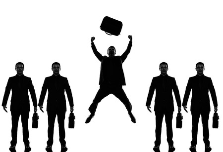 triumphant: business man people standing in a row triumphant in silhouette shadow withe background