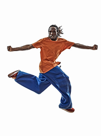 breakdancing: one hip hop acrobatic break dancer breakdancing young man jumping silhouette white background