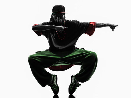 hip hop dance: one hip hop acrobatic break dancer breakdancing young man silhouette white background