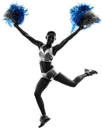 porrista: una mujer joven estudio cheerleader silueta sobre fondo blanco