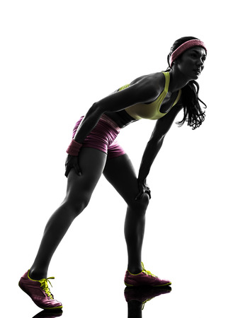 muscle cramp: one  woman runner running pain muscle cramp in silhouette on white background