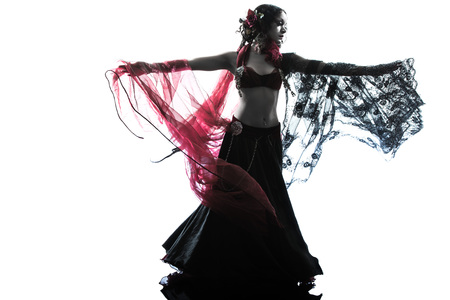 one arabic woman belly dancer dancing silhouette studio isolated on white background Stock Photo