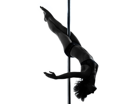 nudity woman: one  woman pole dancer dancing in silhouette studio isolated on white background nudity content