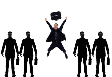 withe: business man people standing in a row triumphant in silhouette shadow withe background