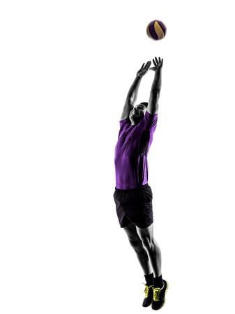 pelota de voley: jugador joven hombre de voleibol en la silueta de fondo blanco Foto de archivo