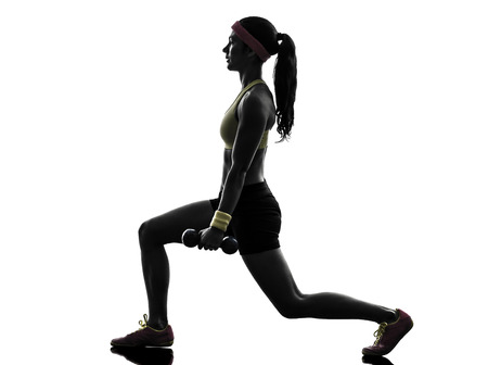 lunges: one woman exercising fitness workout lunges crouching weight training in silhouette on white background Stock Photo