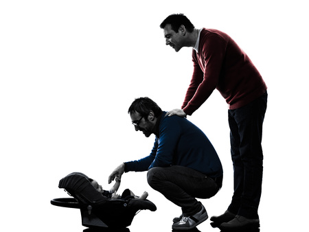 white men: homosexuals parents men family with baby in silhouettes on white background