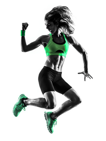 actions: one caucasian woman exercising  fitness jumping in studio silhouette isolated on white background Stock Photo