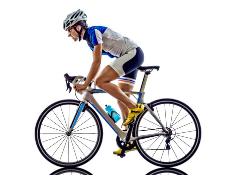 an action: woman triathlon ironman athlete  cyclist cycling on white background