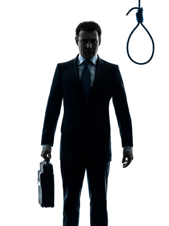 suicidal: one  businessman standing in front of hangmans noose in silhouette studio isolated on white background