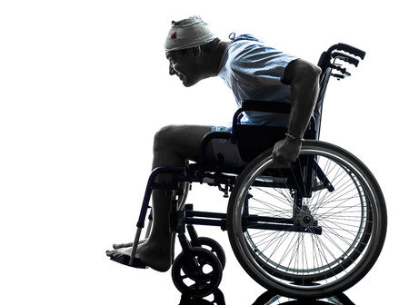 careless: one funny careless injured man in wheelchair in silhouette studio on white background