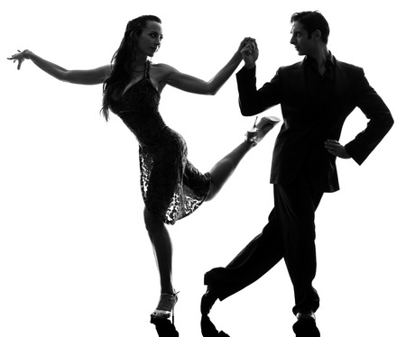 one  couple man woman ballroom dancers tangoing in silhouette studio isolated on white background Stock Photo