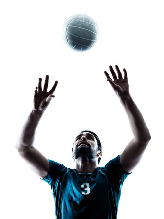 volleyball: one caucasian man volleyball in studio silhouette isolated on white background