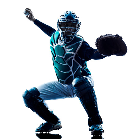 baseball catcher: one caucasian man baseball player playing  in studio  silhouette isolated on white background Stock Photo