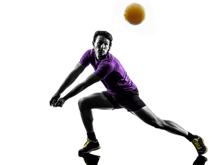 young volley ball player man in silhouette white background Imagens