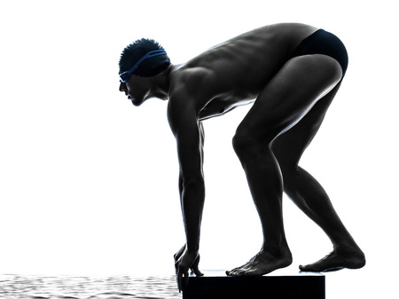 diving: one young man swimmer swimming in silhouette on white background