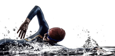 triathlon: man triathlon iron man athlete swimmers swimming in silhouette on white background Stock Photo