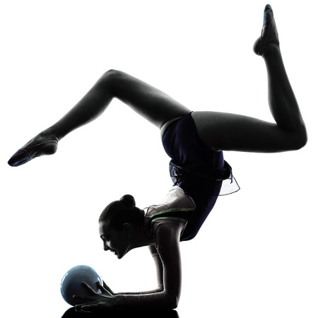 gymnastics silhouette: one caucasian woman exercising Rhythmic Gymnastics in silhouette isolated on white background