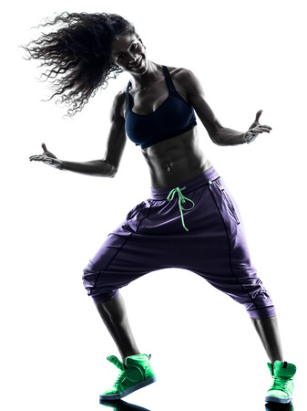 break dancer: one african woman woman zumba dancer dancing exercises  in studio silhouette isolated on white background Stock Photo