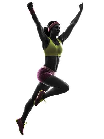 deportistas: una mujer running salto en silueta sobre fondo blanco Foto de archivo