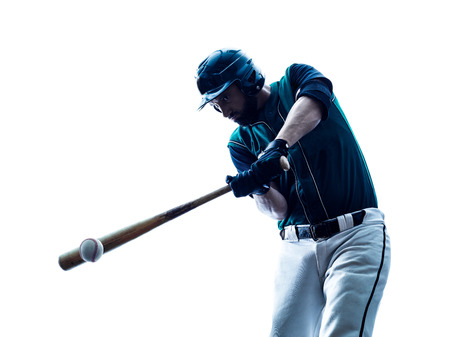 白い背景に分離されたスタジオ シルエットで遊ぶ 1 つの白人男性野球選手 写真素材