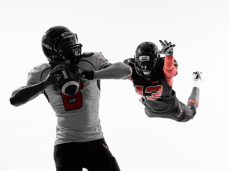 sacked: two american football players quarterback sacked in silhouette shadow on white background