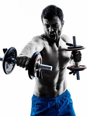 ein kaukasisch Mann mit der Ausübung Fitness Gewichte Übungen im Studio Silhouette auf weißem Hintergrund isoliert Lizenzfreie Bilder