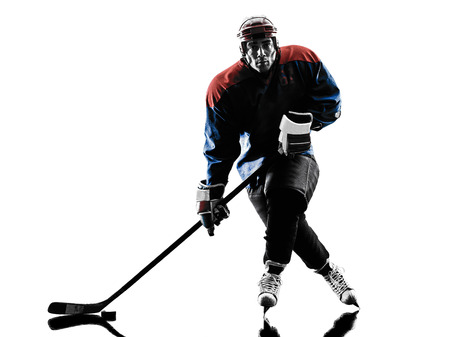 hockey player: one caucasian man ice hockey player  in studio  silhouette isolated on white background Stock Photo
