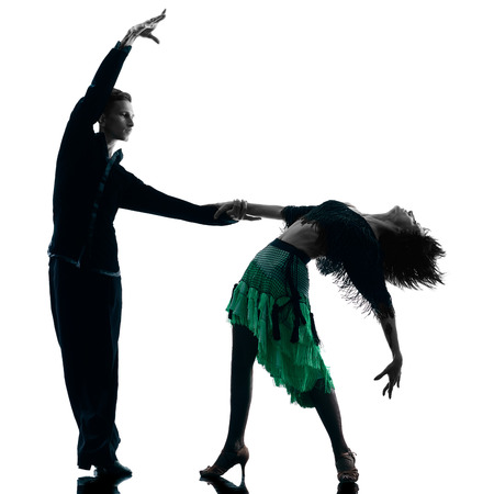 couple dancing: one caucasian elegant couple dancers dancing in studio silhouette isolated on white background