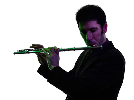 transverse: one caucasian man  playing transverse flute player in studio silhouette isolated on white background
