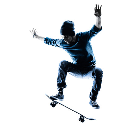 man jump: one caucasian man skateboarder skateboarding  in silhouette isolated on white background