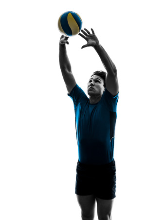 Volley: young volley ball player man in silhouette white background Stock Photo