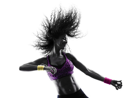 one african woman woman zumba dancer dancing exercises in studio silhouette isolated on white background Imagens