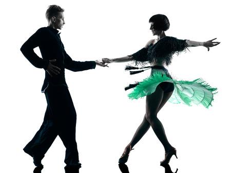 白い背景に分離されたスタジオ シルエットでダンス 1 つの白人のエレガントなカップル ダンサー 写真素材