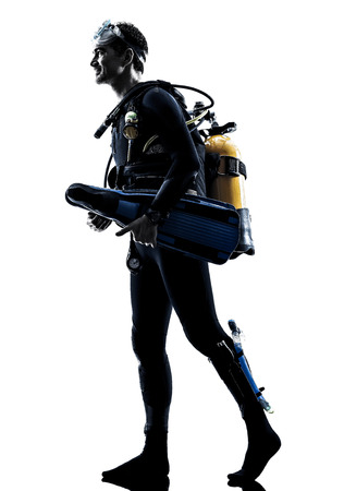 diving equipment: one caucasian scuba diver diving man  in studio  silhouette isolated on white background