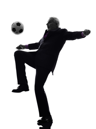 senior business man: One Caucasian Senior Business Man playing soccer Silhouette White Background Stock Photo