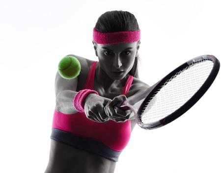 白い背景に分離されたスタジオ シルエットで一人の女性のテニス選手 写真素材
