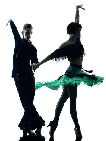 bailando salsa: un cauc�sico elegantes bailarines pareja bailando en el estudio de silueta aislados sobre fondo blanco