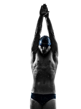 one young man swimmer swimming in silhouette on white background
