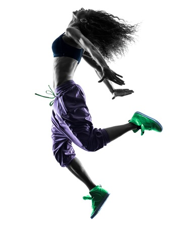 hip hop dancing: one african woman woman dancer dancing exercises  in studio silhouette isolated on white background