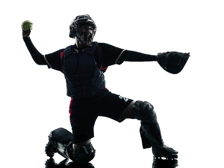 baseball player: one woman playing softball players in silhouette isolated on white background